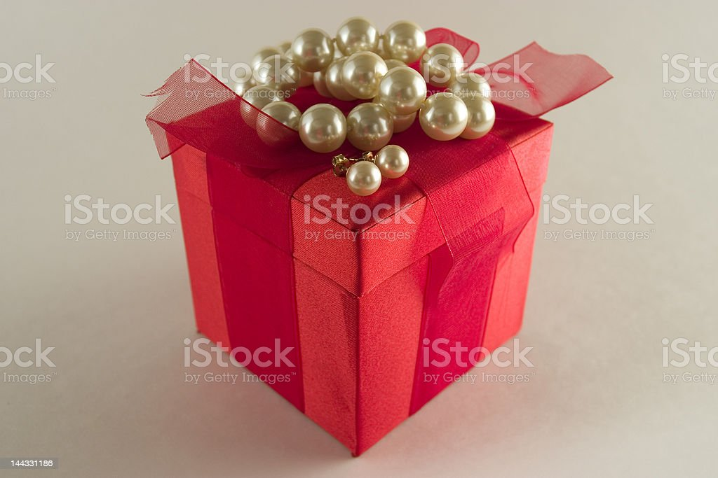 Pearls and a Gift Box stock photo