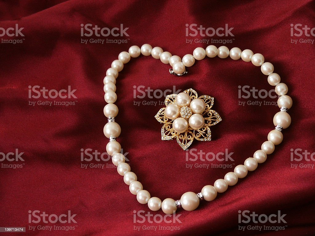 Pearls and brooch royalty-free stock photo