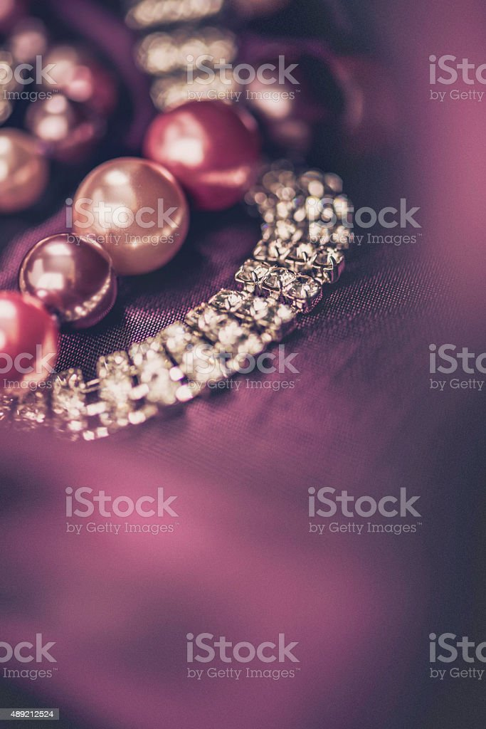 Pearls and diamond jewelry collection on marsala organza stock photo