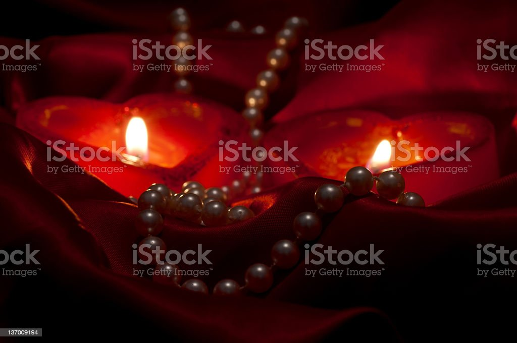 Pearls and heart candles royalty-free stock photo