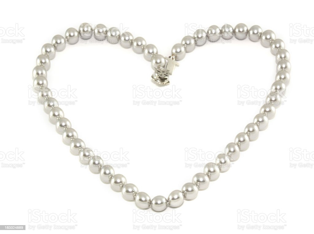 Pearls arranged in shape of a heart stock photo
