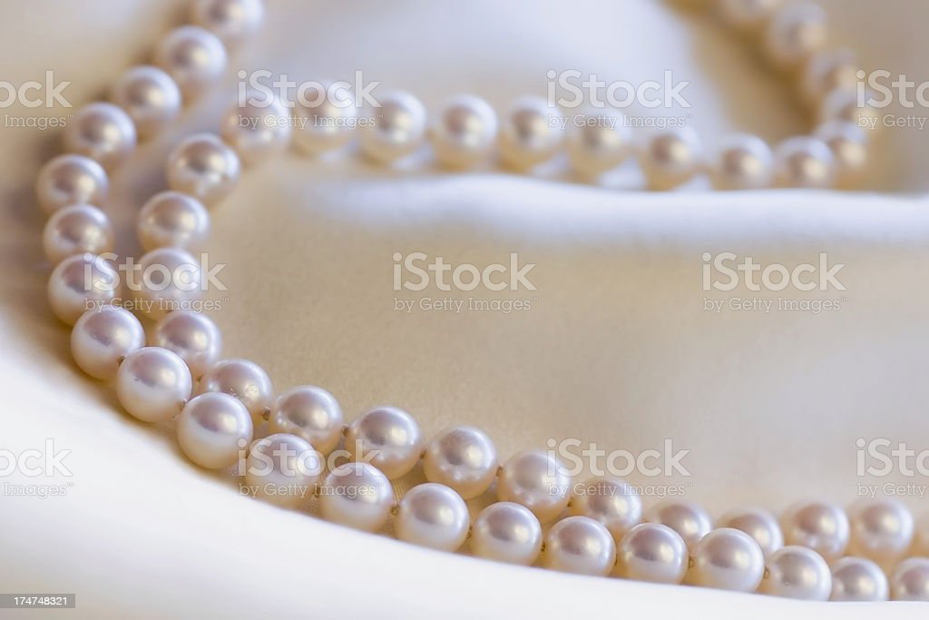 Pearls on Cream Silk royalty-free stock photo