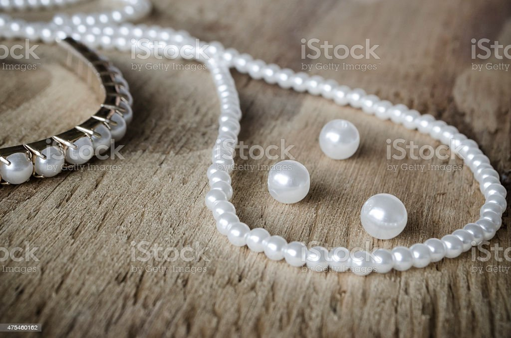 Pearls on Rustic Wood stock photo
