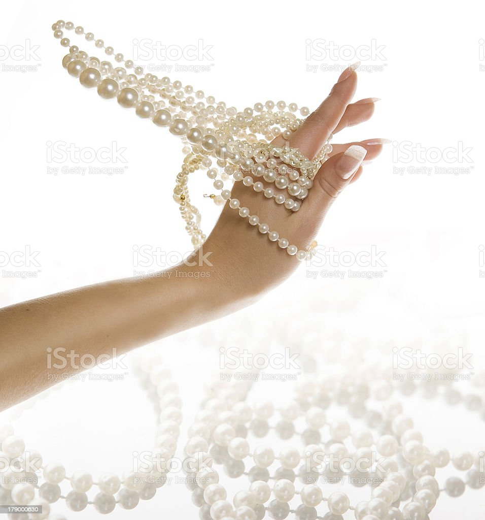 pearls on the hand , white  background royalty-free stock photo