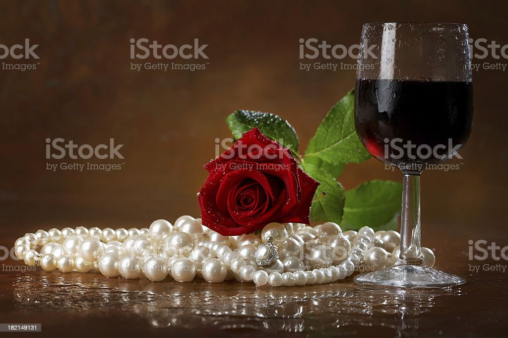 Pearls rose and wine royalty-free stock photo