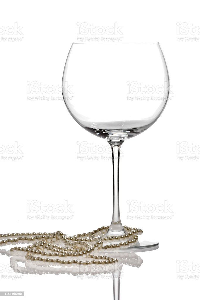Pearls wrapped around a wine glass royalty-free stock photo