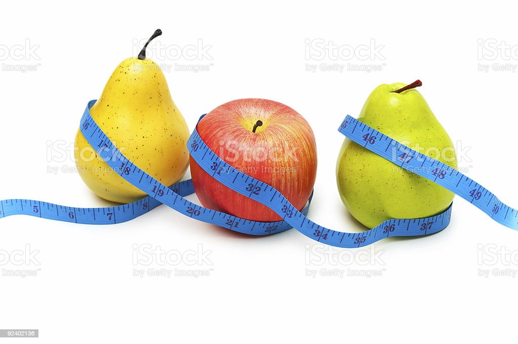Pears and apple illustrating fruit dieting concept royalty-free stock photo