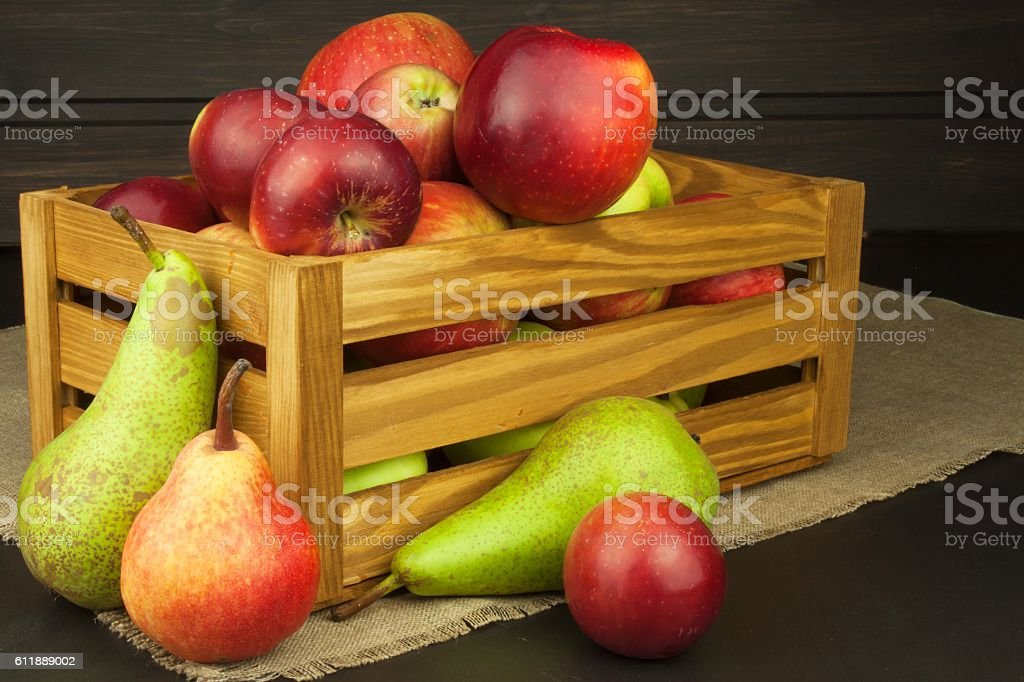 Pears and apples on wooden table. Autumn Fruits. stock photo
