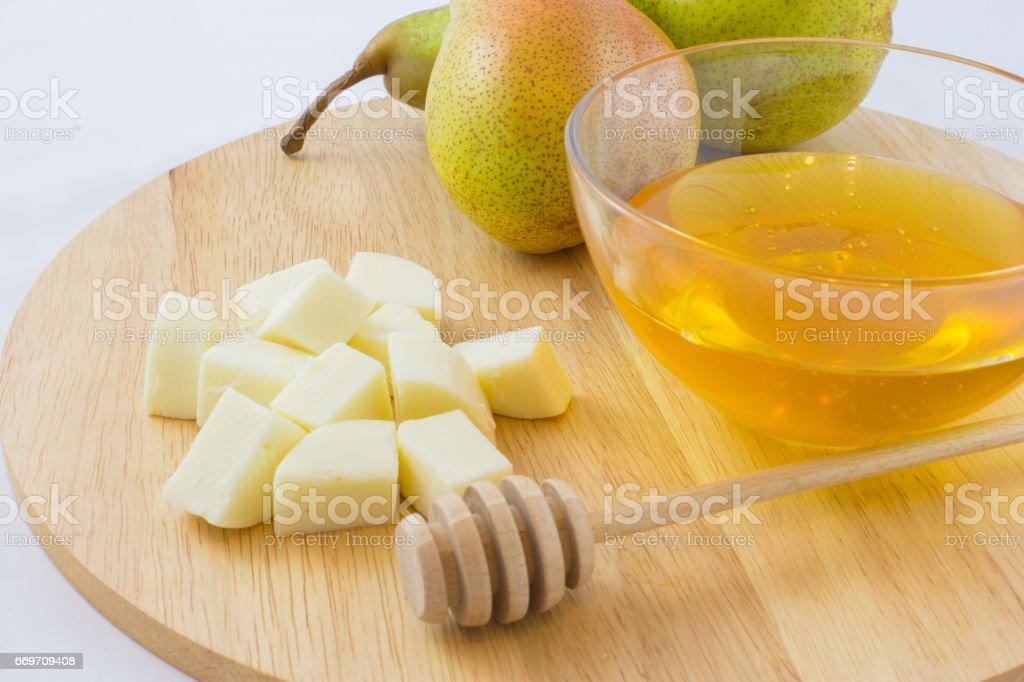 Pears, cheese and honey on a wooden tray. stock photo