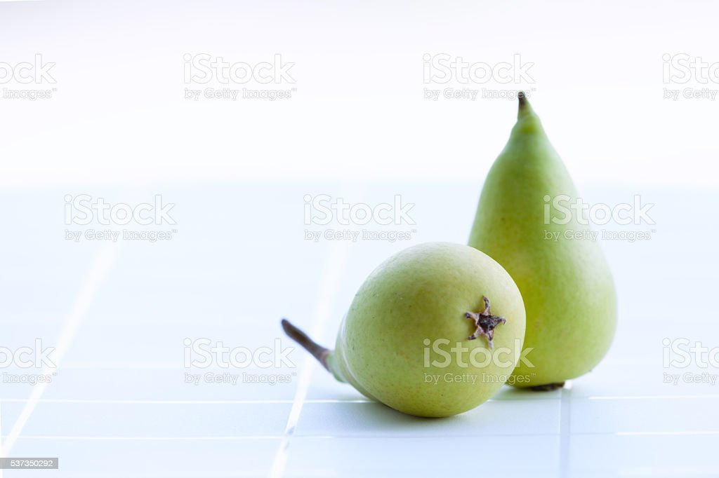 Pears green on the table stock photo