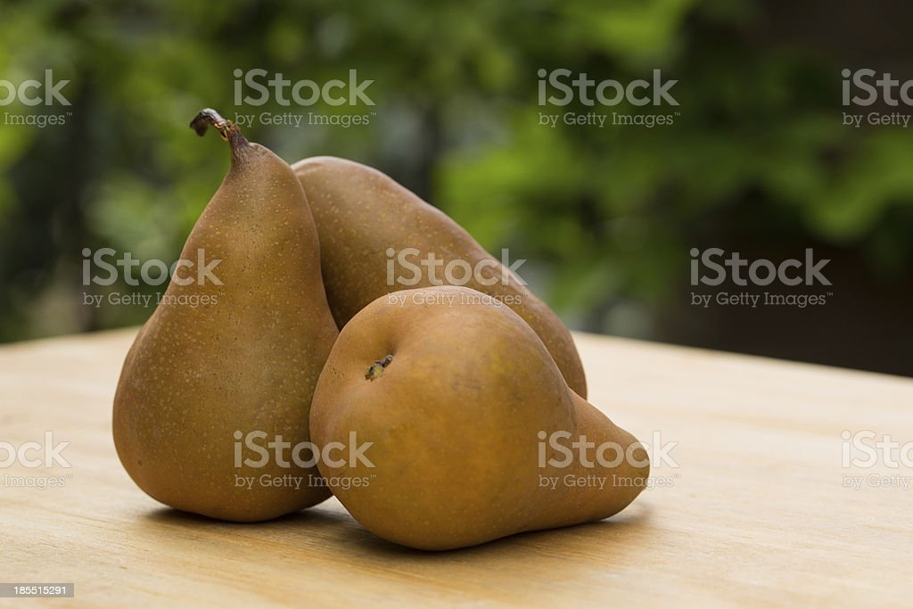 Pears in the Garden on Wood Table stock photo