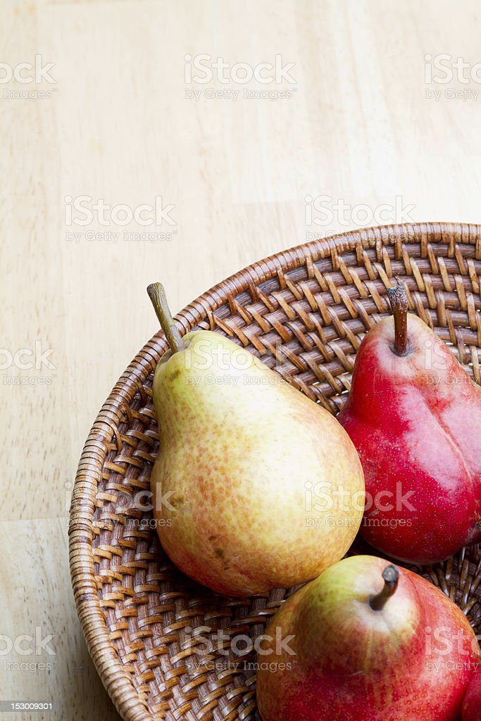 Pears in Wicker Basket royalty-free stock photo