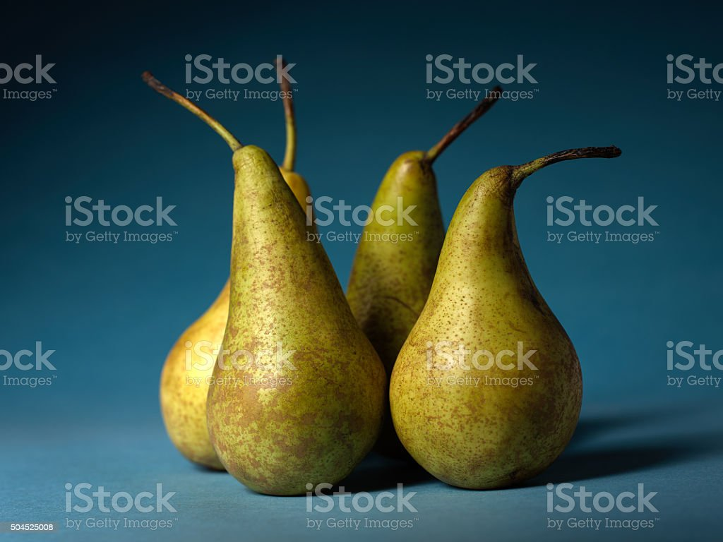 Pears on a blue background. stock photo
