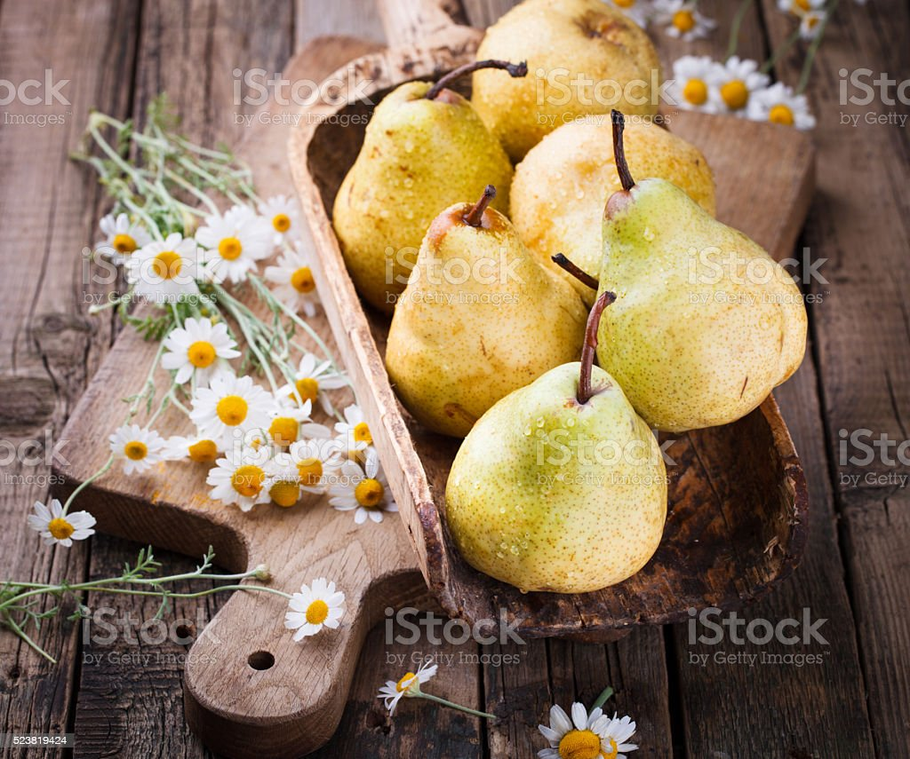 Pears on the aged wooden background stock photo
