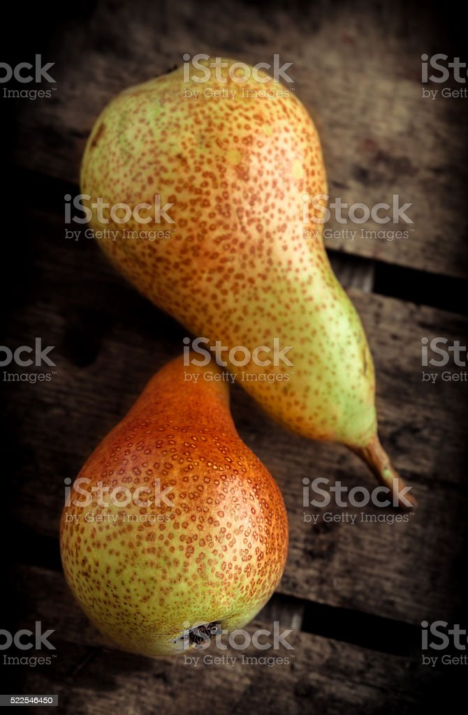 Pears on wooden table stock photo