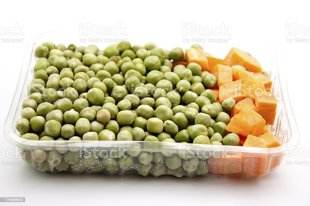 Peas and carrots in packaging stock photo
