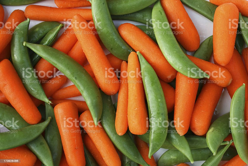 Peas and Carrots stock photo