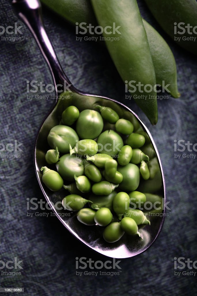 Peas in a Spoon royalty-free stock photo