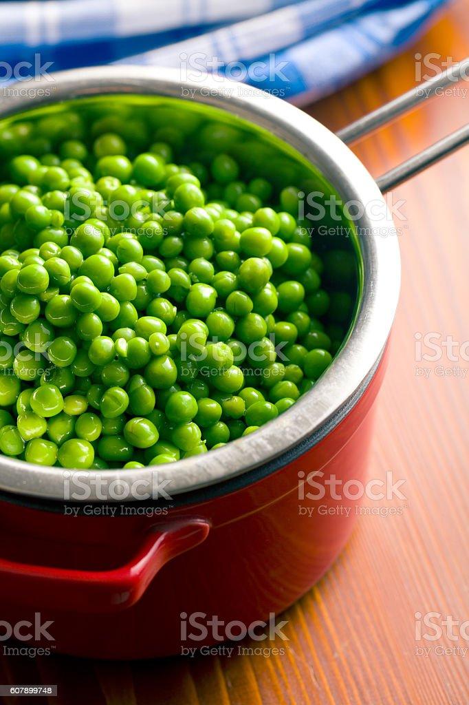 peas in colander stock photo