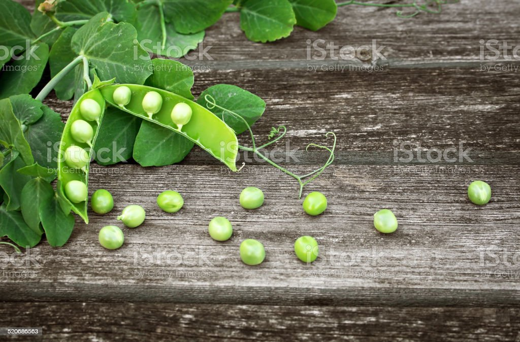 Peas on wooden board stock photo