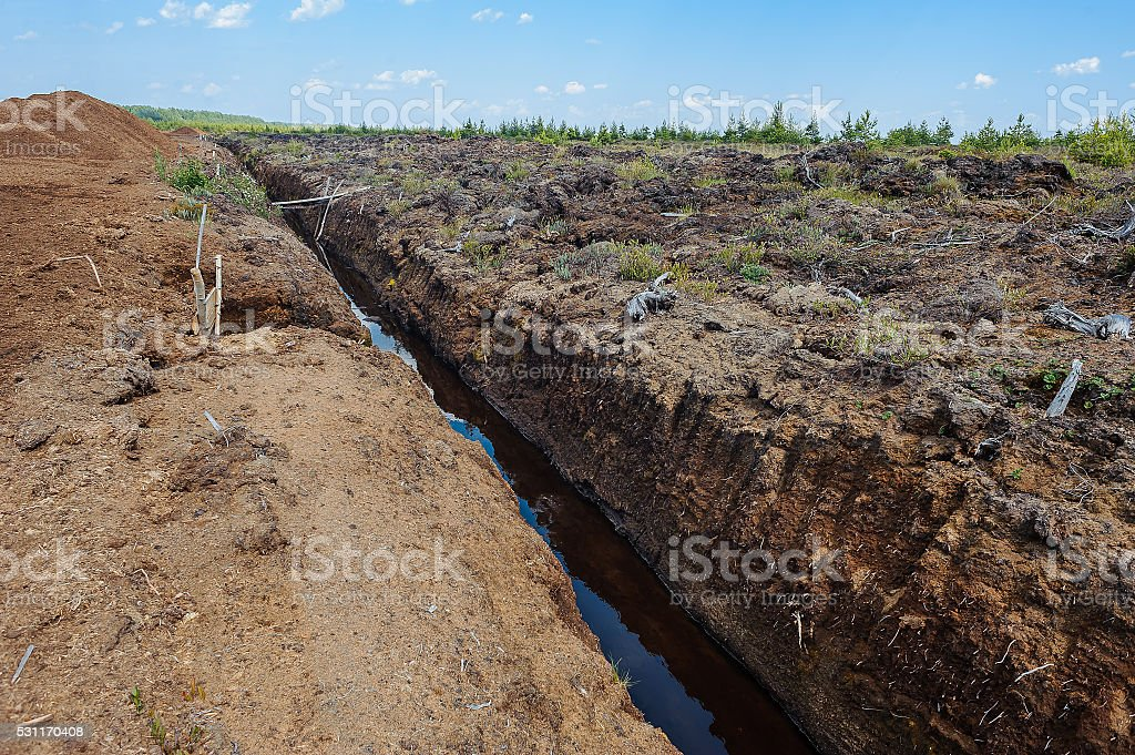 Peat extraction in a field stock photo