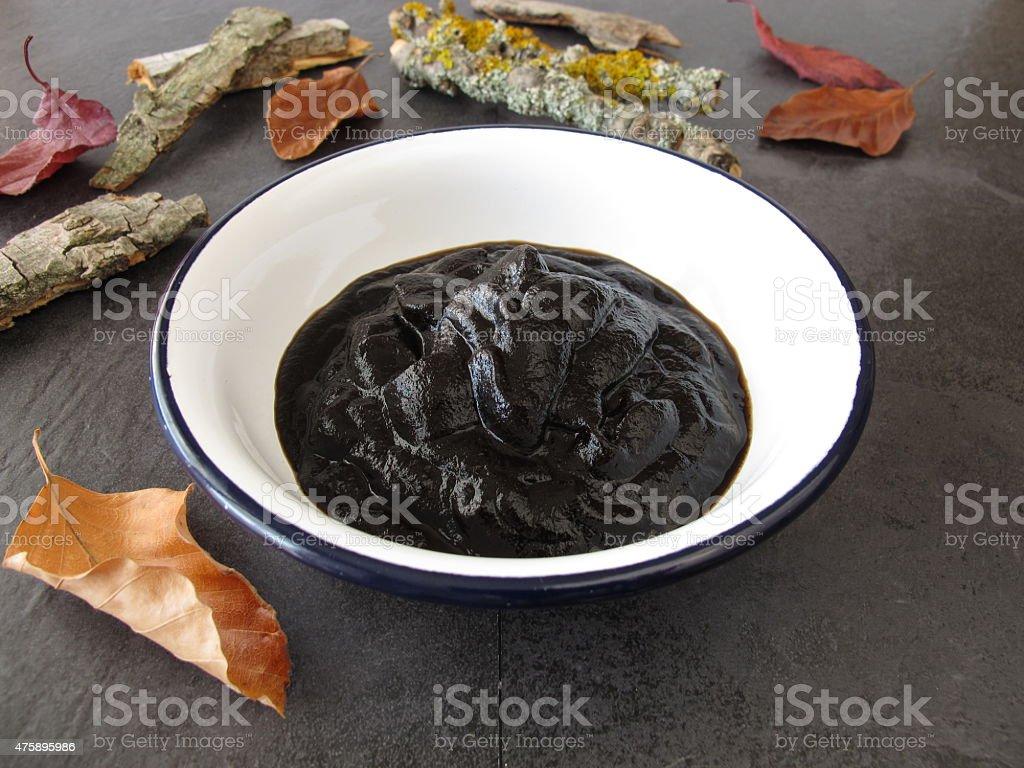 Peat pulp bath therapy stock photo