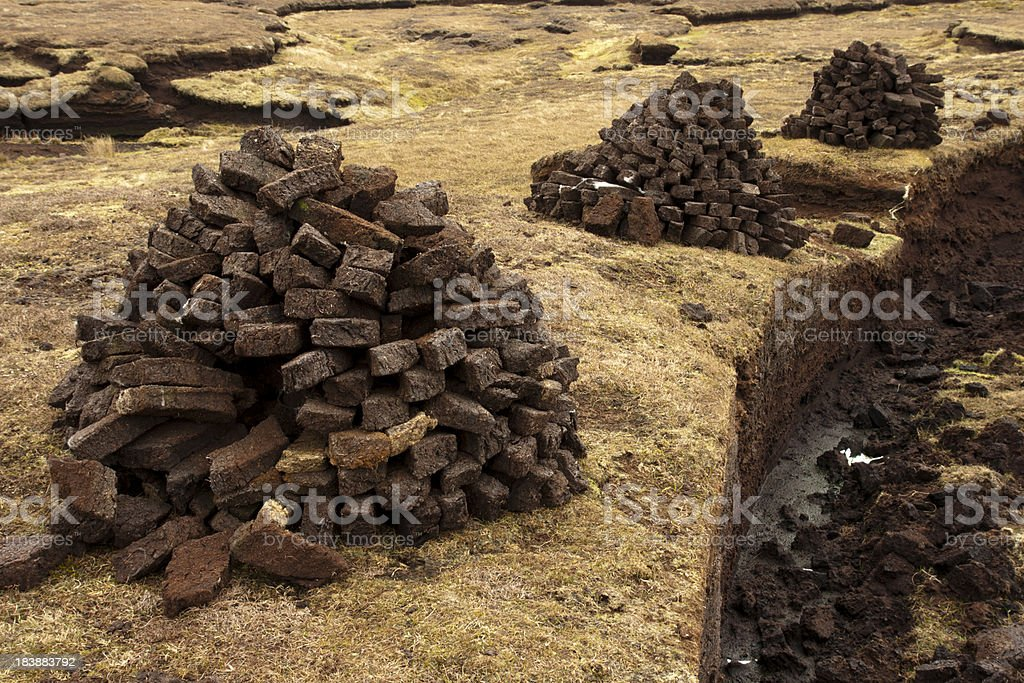 Peat stack on the Shetland Islands stock photo