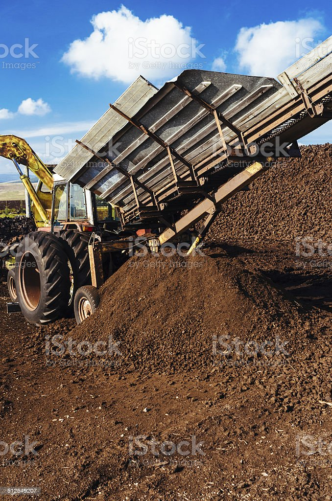 Peat works with milling machine stock photo