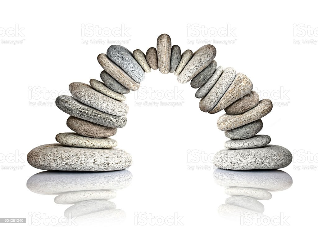 Pebble arch isolated on white background stock photo