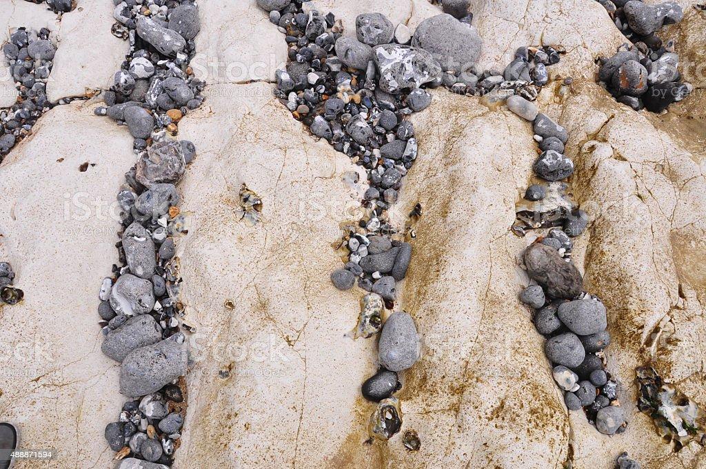 Pebble Beach at Seven Sisters White Chalk Cliffs at Birling Gap Beach stock photo