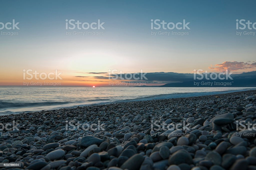 Pebble beach at sunset stock photo