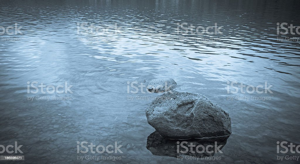 Pebble in Grasmere lake stock photo