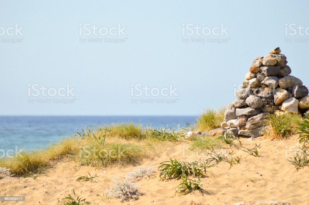 Pebble mound on a sand dune stock photo