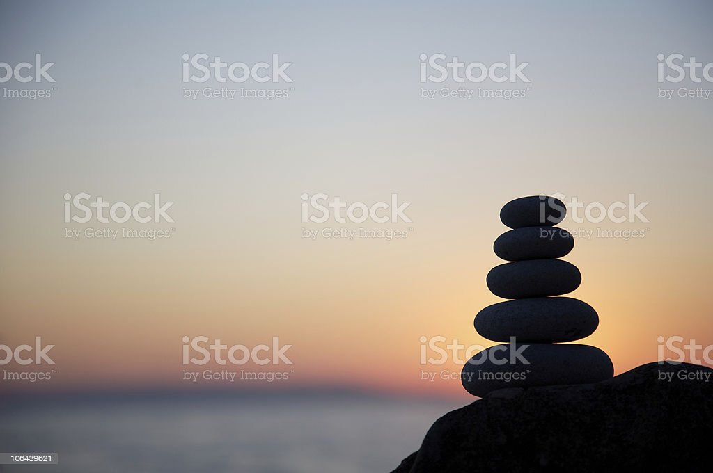 Pebble stack at sunset royalty-free stock photo