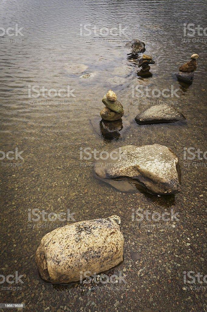 Pebble stacks in Grasmere lake royalty-free stock photo