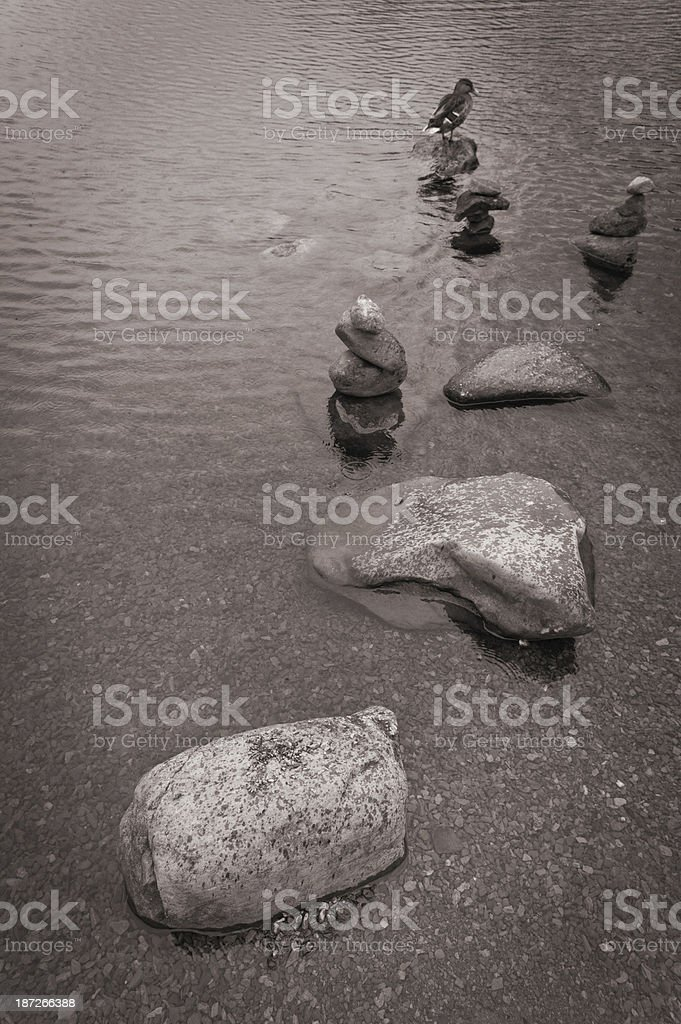 Pebble stacks in Grasmere lake royalty-free stock photo