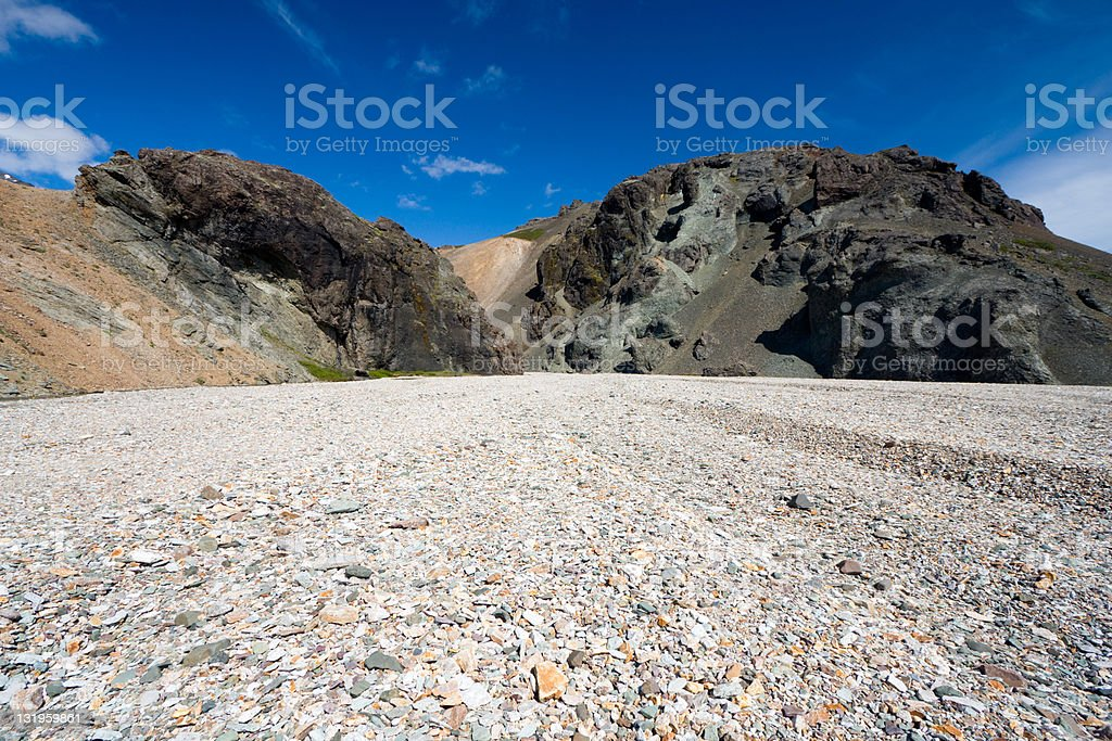 Pebble Stone Field In Front Of Volcanic Mountains royalty-free stock photo