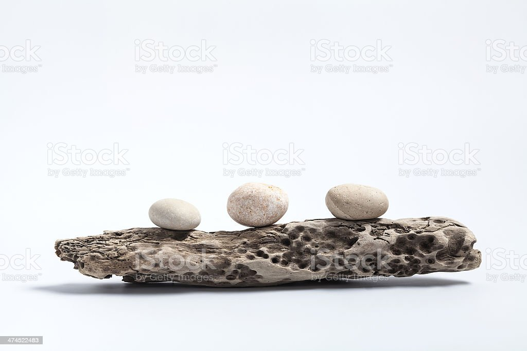 pebbles and driftwood stock photo