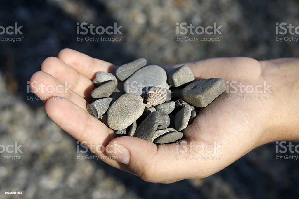 pebbles and hand stock photo