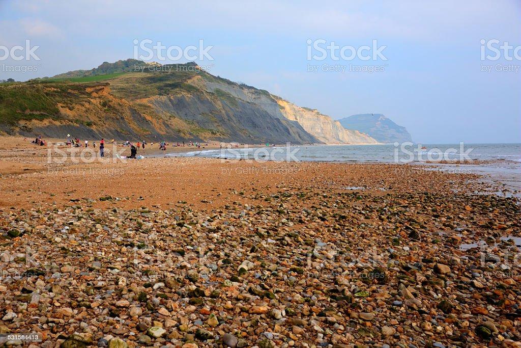Pebbles and shingle Charmouth Dorset England UK with coast stock photo