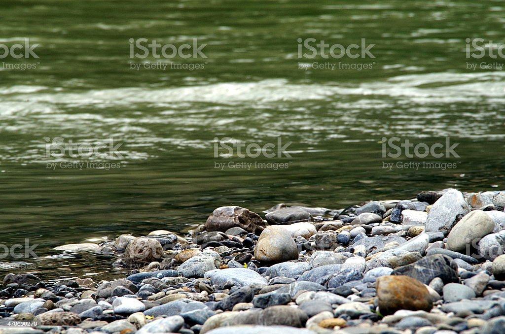 Pebbles at the lakeside stock photo