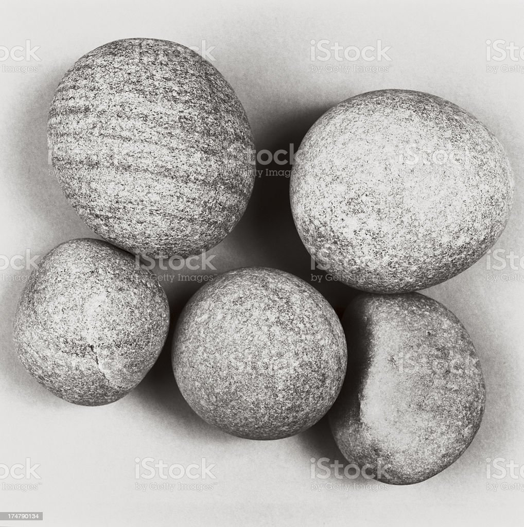 Pebbles close-up on white paper - Natural texture and detail stock photo