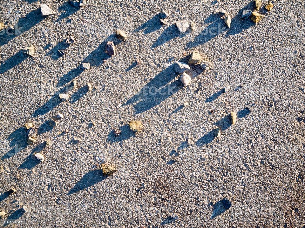 Pebbles concrete middle stock photo
