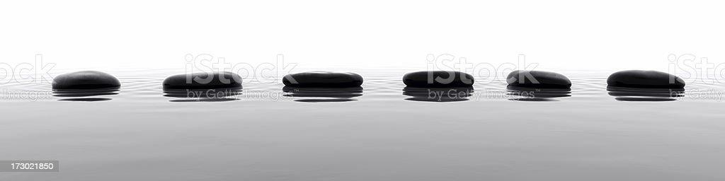 Pebbles in Water VI stock photo