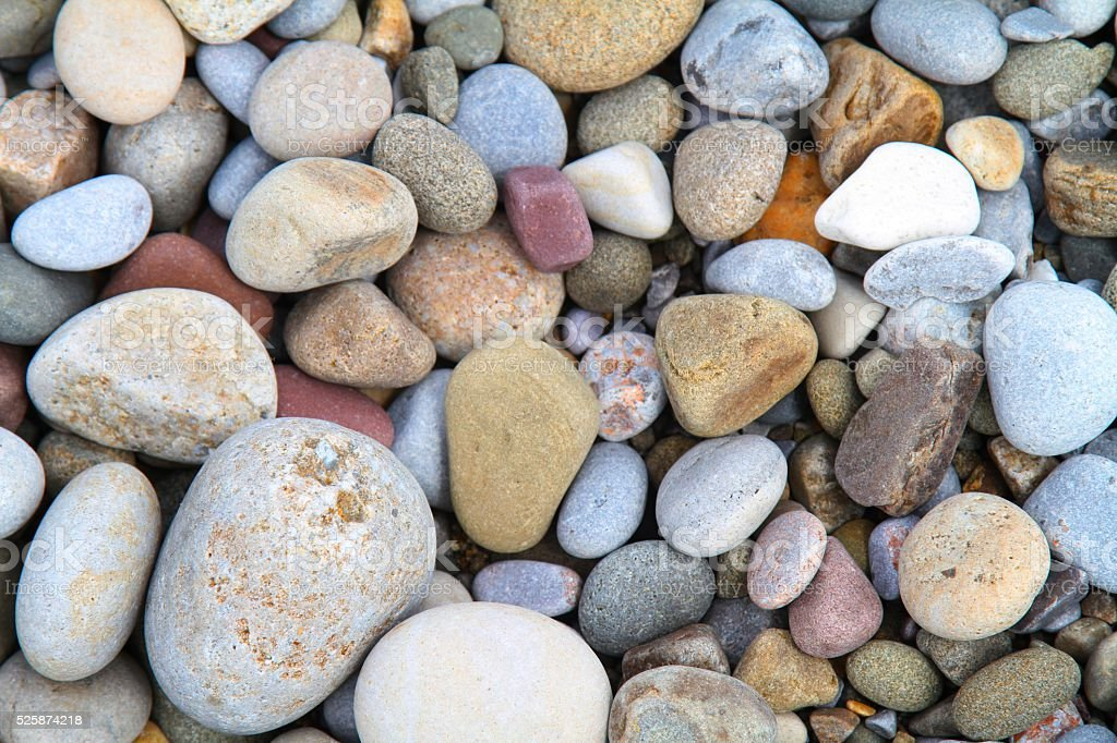 Pebbles on beach background stock photo