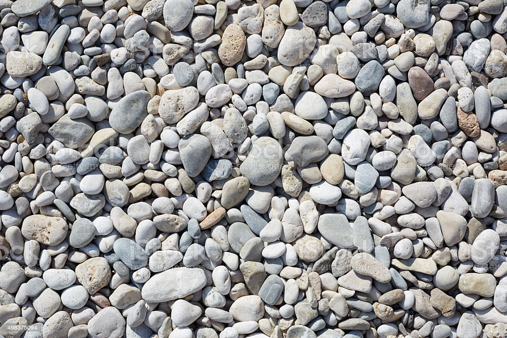 Pebbles on the beach, abstact stone background stock photo