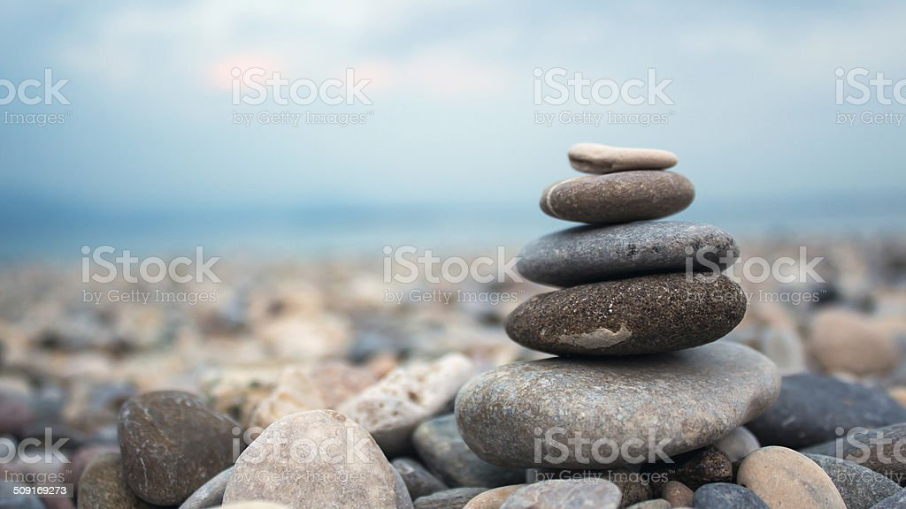 Pebbles on the shore of a lake stock photo