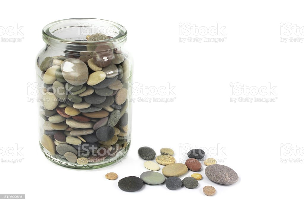 Pebbles or Beach stones in a glass jar stock photo