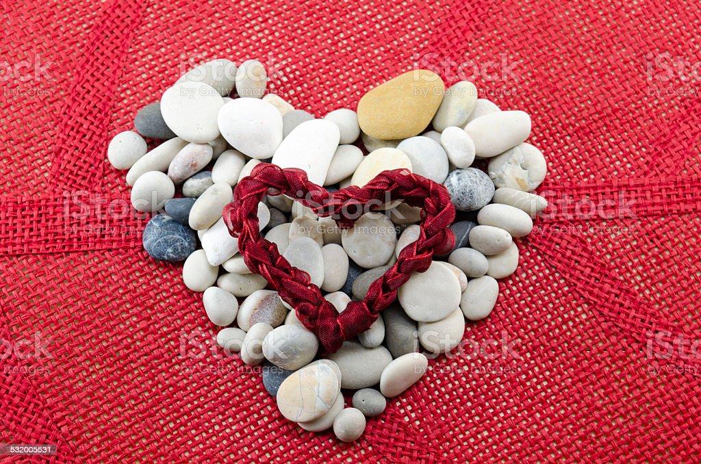 Pebbles shaped into a heart royalty-free stock photo