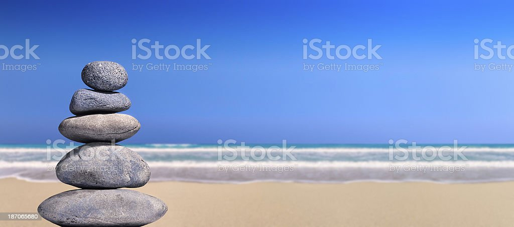 Pebbles stack in a tropical beach. royalty-free stock photo